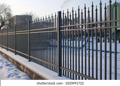 Image of a Beautiful decorative cast iron wrought fence with artistic forging. Metal guardrail close up.