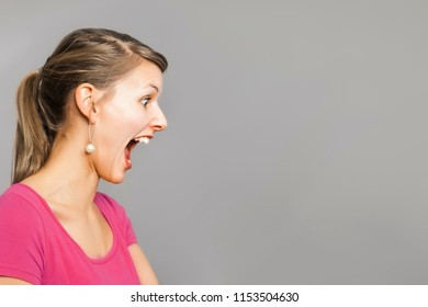 An image of a beautiful but frightened woman