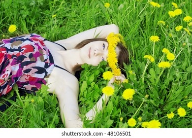 The image of a beautiful girl on a background of flowering flowers