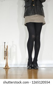 Image of beautiful legs of black tights on denim miniskirt