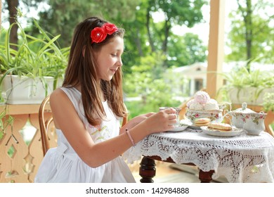 Image of beautiful little girls with tea