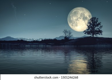 An image of a beautiful moon and stars background