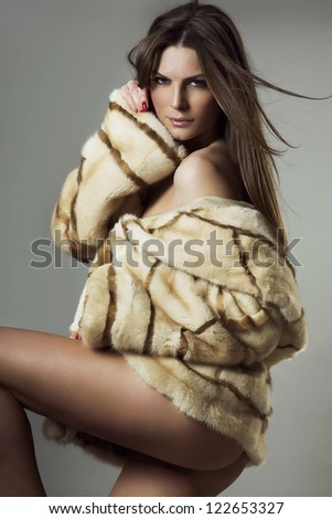 naked woman in coat