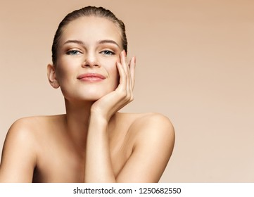 Image of beautiful smiling girl on beige background. Beauty & Skin care concept