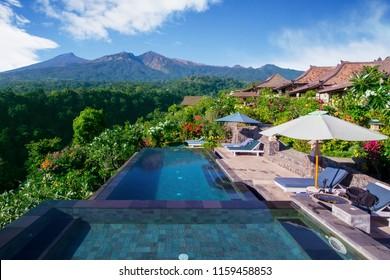 Image of beautiful swimming pool with Rinjani mountain scenery in Lombok, Indonesia