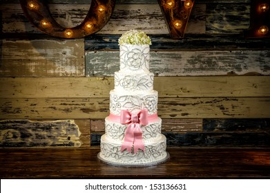 Image of a beautiful wedding cake with a rustic background