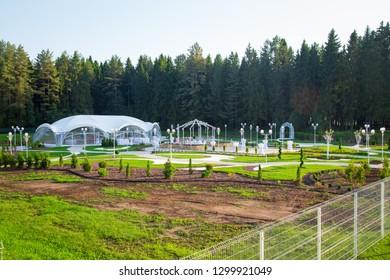 Image of the beautiful white wedding veranda among forest