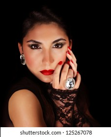 Image of beautiful woman with red sexy lips, closeup portrait of gorgeous female isolated on black background, seductive female wearing luxury diamond jewelery, passion and glamor concept