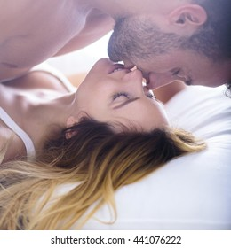Image of beautiful woman seducing her boyfriend in bed