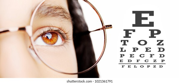 Image of a beautiful young girl wearing glasses. Close up shot