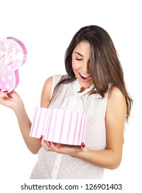 Image of beautiful young lady opened giftbox, cute brunette female excited of gift, beautiful woman holding in hands present and isolated on white background, Valentine day, romantic holiday