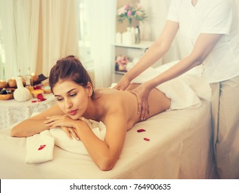image of Beautiful young woman receiving massage in spa salon