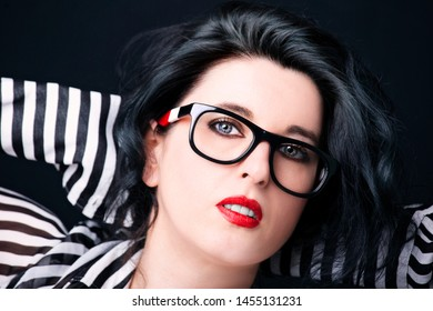 Image of a beautiful young woman wearing glasses.