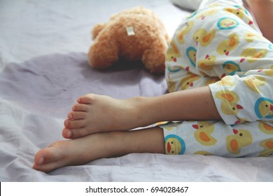 Image of Bed-wetting situation in 4 or 5 years old girl.Girl wet the bed while she was sleeping.Selective focus