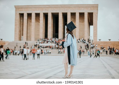 image from behind of graduating students wrapping each other in dossier