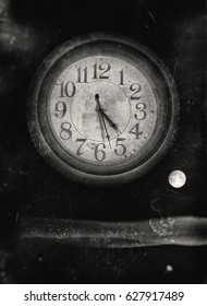 Image of a big clock as a planet closing in on planet earth with a scary subtile message that the time is running out, textured with scratches and stains in black and white for a doomsday effect.