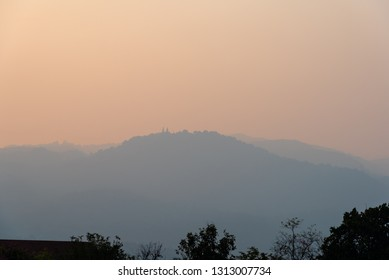 Image of Big mountain (Doi Suthep) in the pollution fog, Chiang Mai Thailand.Small particle PM 2.5 micron in bad air come from farmer burning dry leaf to make the farm.