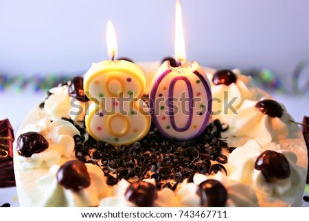 An Image Of A Birthday Cake With Candle