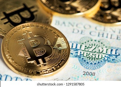 Image of Bitcoins with Chilean pesos banknotes. Bitcoins virtual money on Chilean banknotes. Bitcoin Cryptocurrency Digital Bitcoin BTC Currency Technology Business Internet Concept Chile Pesos Money
