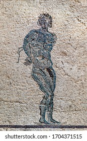 Image of a black knitted slave. Antique mosaic from the house of Dionysus. The third century BC. Paphos Archaeological Park. Cyprus.