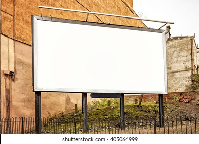 Image of blank advertising billboard in an urban setting.