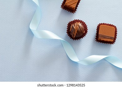 Image of blue background and chocolate Valentine