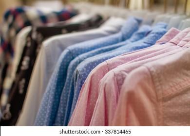 Image blue and pink polka dot shirt hanging on a hanger