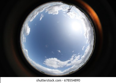 image of blue sky with clouds, circle effect from fisheye lens