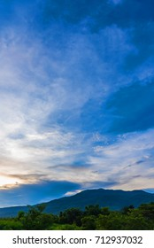 image of  blue sky and mountain in background at Doi Suthep Chiang Mai,Thailand.(vertical)