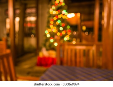 image of blur restaurant and Christmas tree in night time for background usage .
