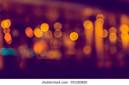 image of blurred bokeh background with warm colorful lights. (vintage tone)