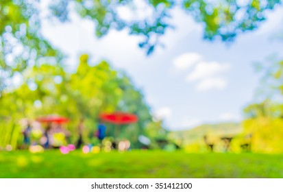 image of blurred outdoor party on day time , in garden for background usage .
