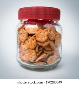 image of a bottle jar with small salt biscuits in it