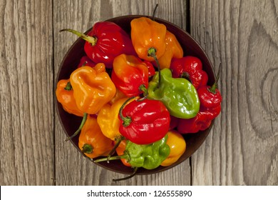 Image of bowl of habanero chili peppers on wooden table