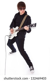 Image of boy in black clothes and sunglasses who is playing on white electric guitar