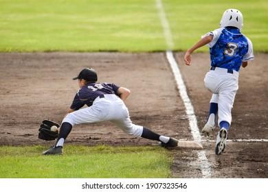 Image of a boy playing baseball.