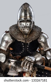Image of brave knight who is sitting on the chair