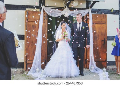 an image of bride and groom in front of church