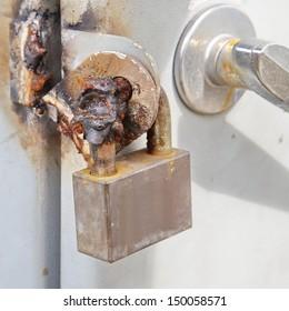 Image of a broken metal lock by welding metal and sparks