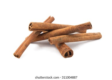 Image of brown stacked cinnamon sticks on white background