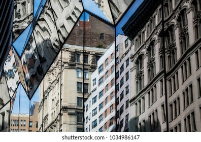Image of buildings reflecting in other buildings