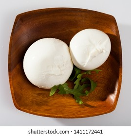 Image of burrata italian white cheese and arugula leaf closeup