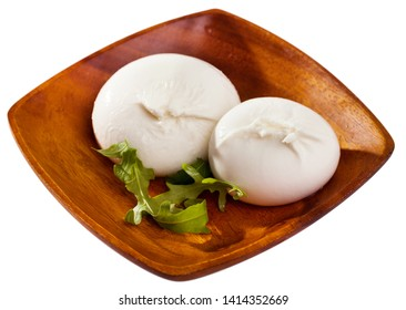 Image of burrata italian white cheese and arugula leaf closeup. Isolated over white background