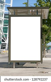 An image of a bus stop with a blank bilboard for your advertising situated in front of the turning torso skyscraper in the swedish city of Malmo.