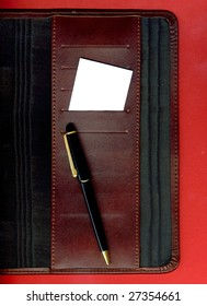 Image of a business card and pen placed on the agenda