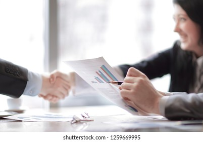 image of a business handshake business women with business partner