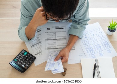 Image of a business man with financial concerns. Think hard about paying off credit card debt, house rent, and family expenses. Financial problem concept