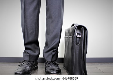 An image of a business man with a suitcase