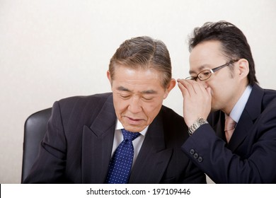 An Image of Business Man Whispering