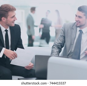 Image of business partners discussing documents and ideas at mee